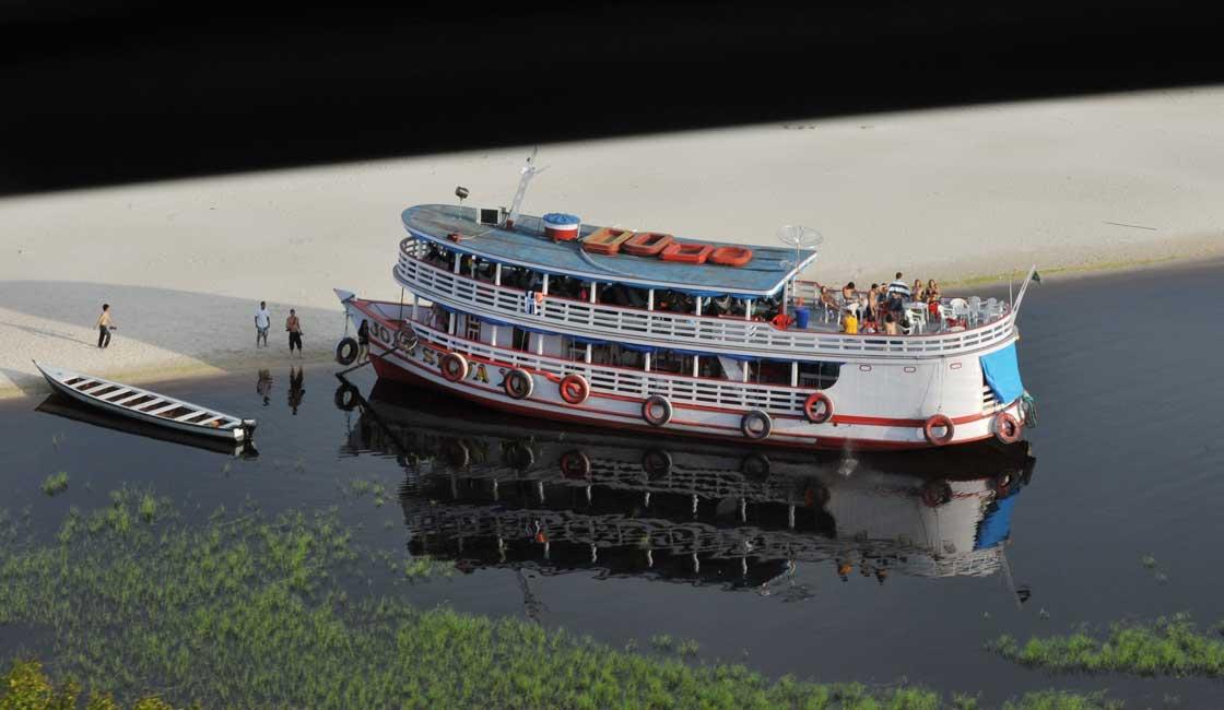 Passenger boat moored at the river bank