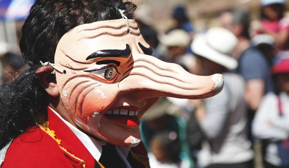 Person wearing a mask with a very long nose