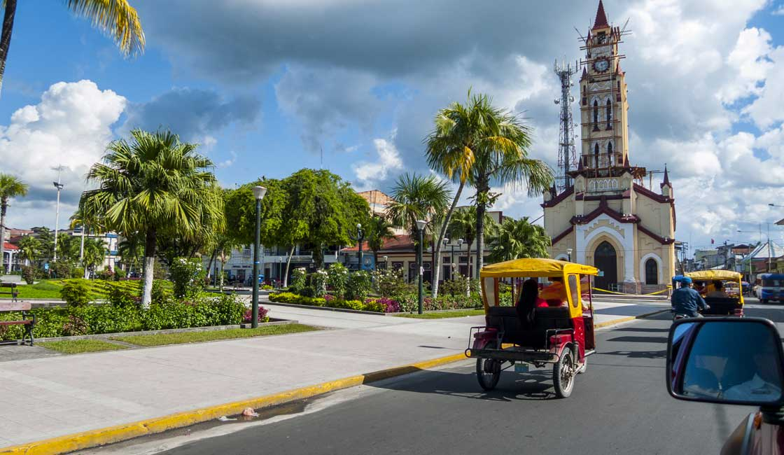 Town square with church and tuk tuks
