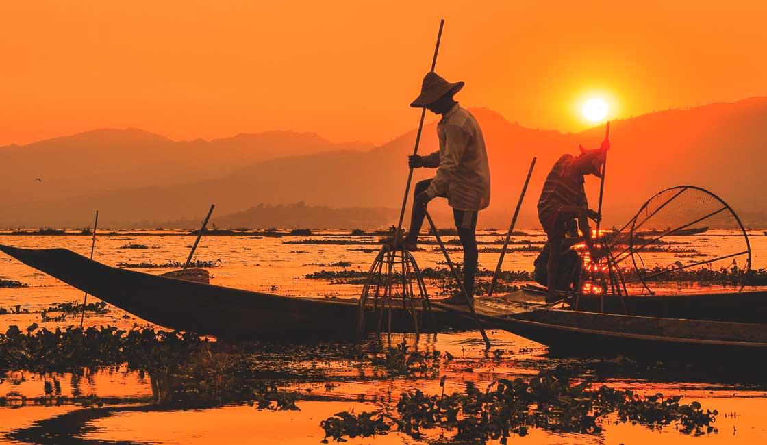 Fishermen on the lake at sunset