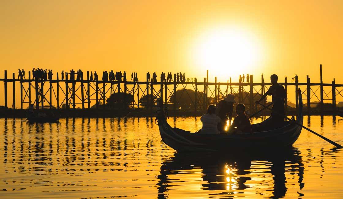 Sampan by the teak bridge at sunset