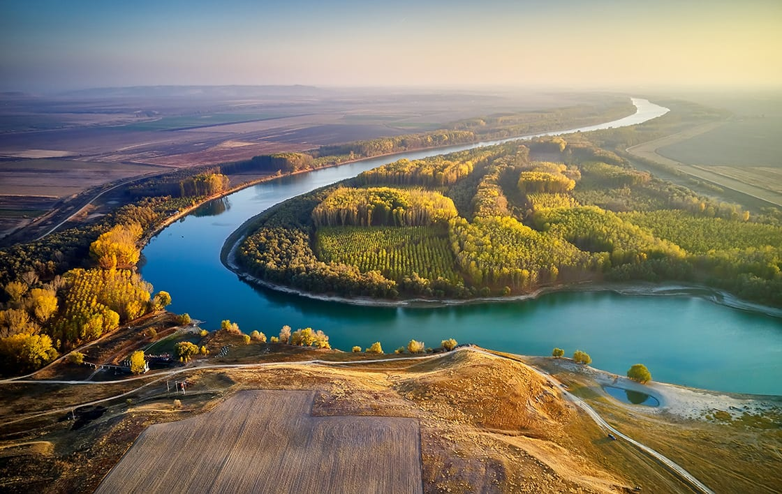 Aerial,View,Of,The,Danube,River,Shore,In,Summer