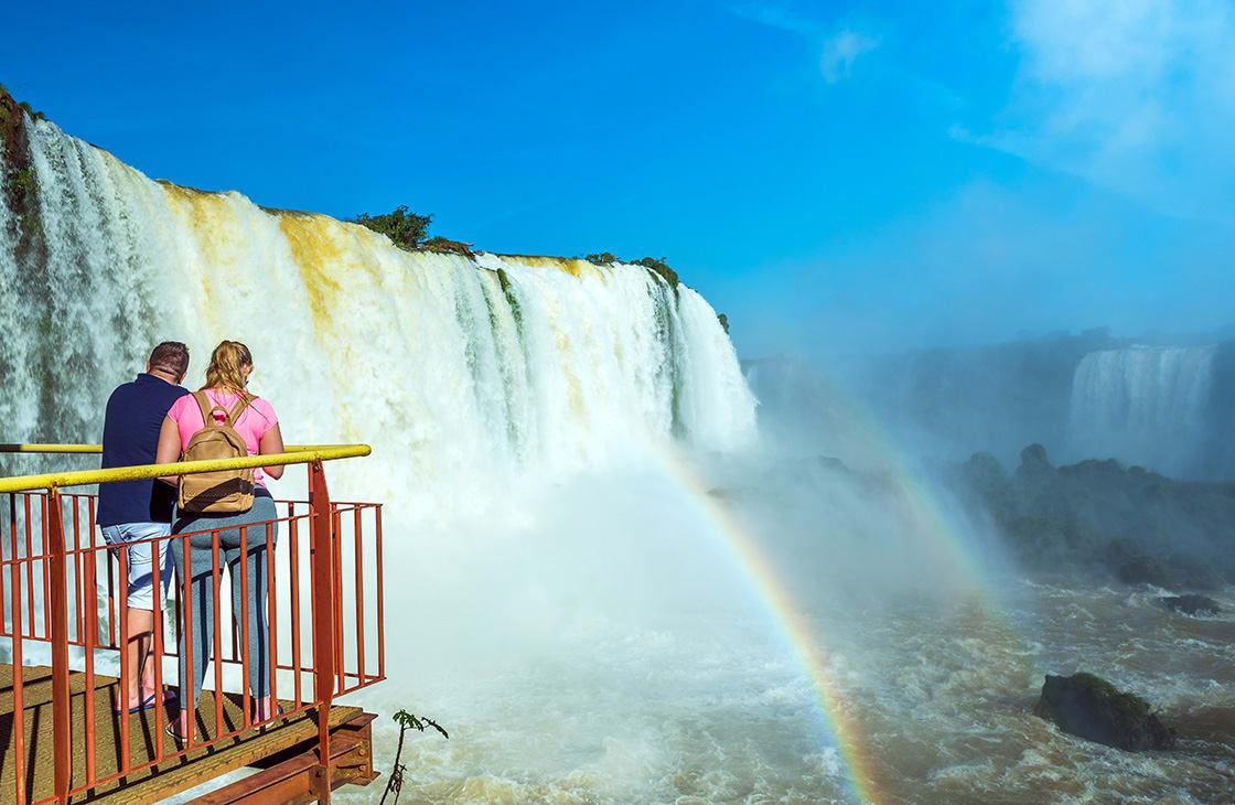 Couple admiring the Iguazu Falls