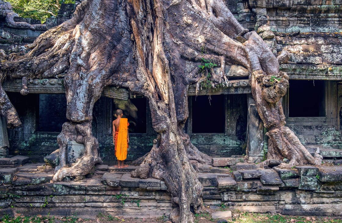 young monk walking into a temple