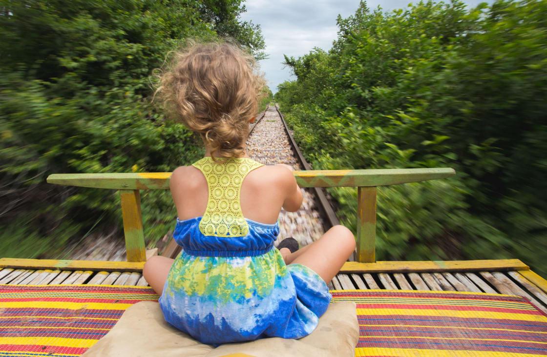 girl aboard the bamboo train