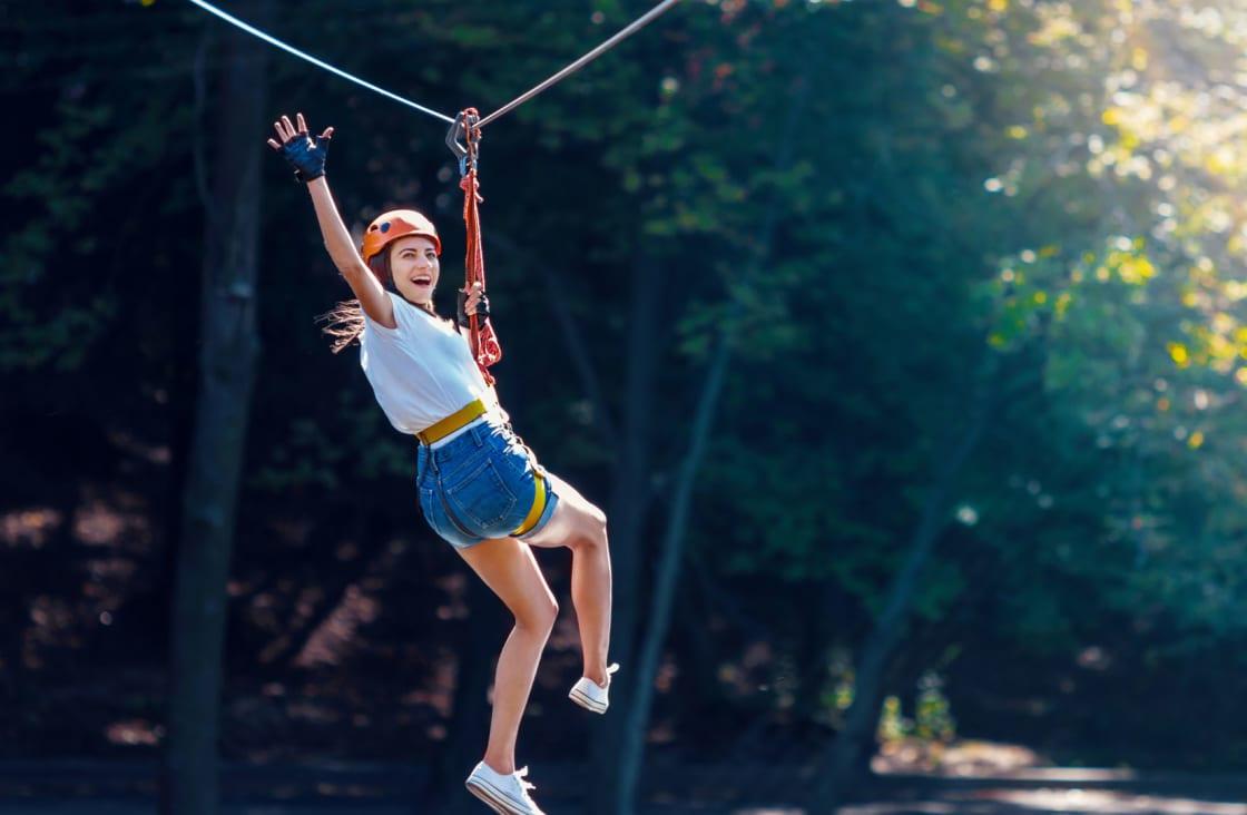 young lady having fun while ziplining
