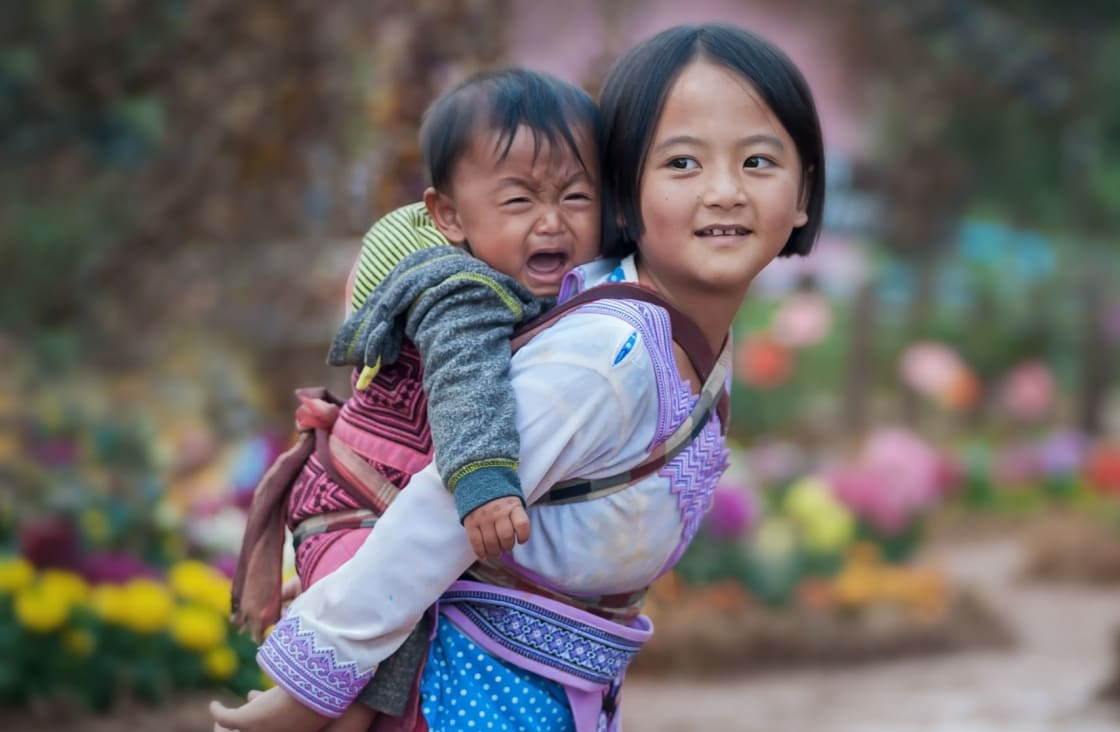 girl and baby in a village in laos