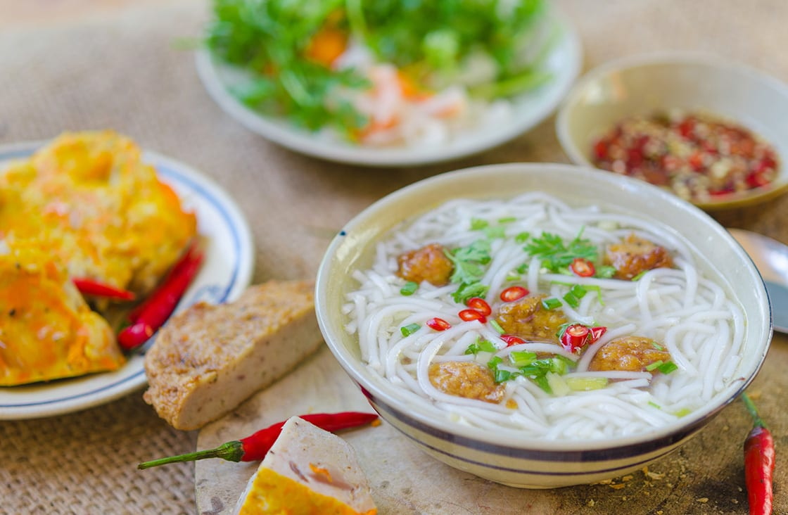 Banh Canh noodles with Baby Clams in Coconut Milk