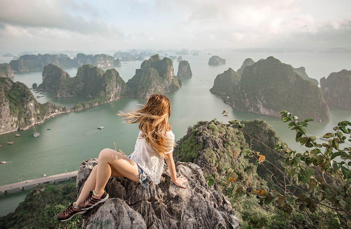 Happy,Smiling,Tourist,At,Bai,Tho,Mountains,Top,Enjoys,The