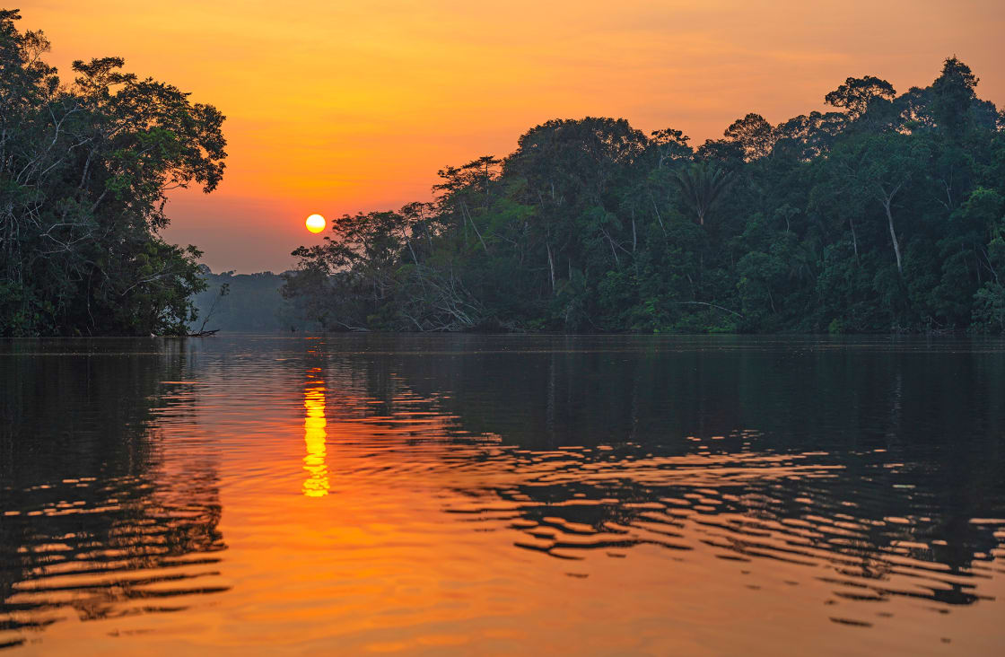 Reflection Of A Sunset, In The Amazon