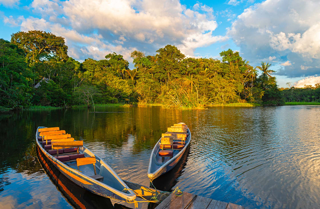 Two,Traditional,Wooden,Canoes,At,Sunset,In,The,Amazon,River
