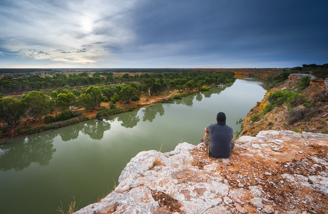 Man,Sitting,Atop,Cliffs,Looking,Over,The,Murray,River