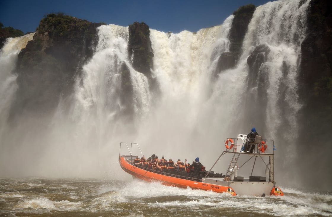 People,In,Boat,To,See,The,Waterfalls,Up,Close,-