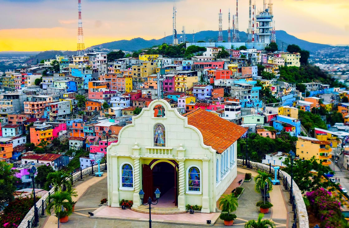 Historic,Hilltop,Church,With,Painted,Hill,Side,Buildings,At,Sunset