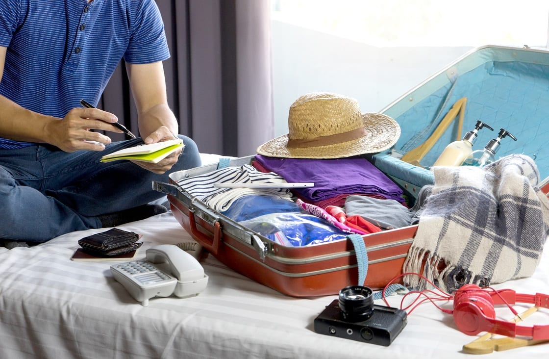 Man,Packing,The,Luggage,Prepare,For,Their,Journey,Trip,With