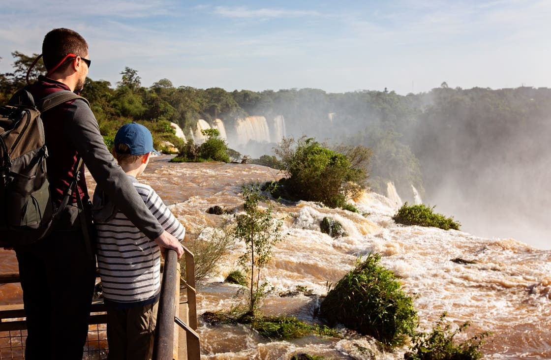 Family of 2: Father And Son Enjoying The Gorgeous View Of The Iguazu Falls