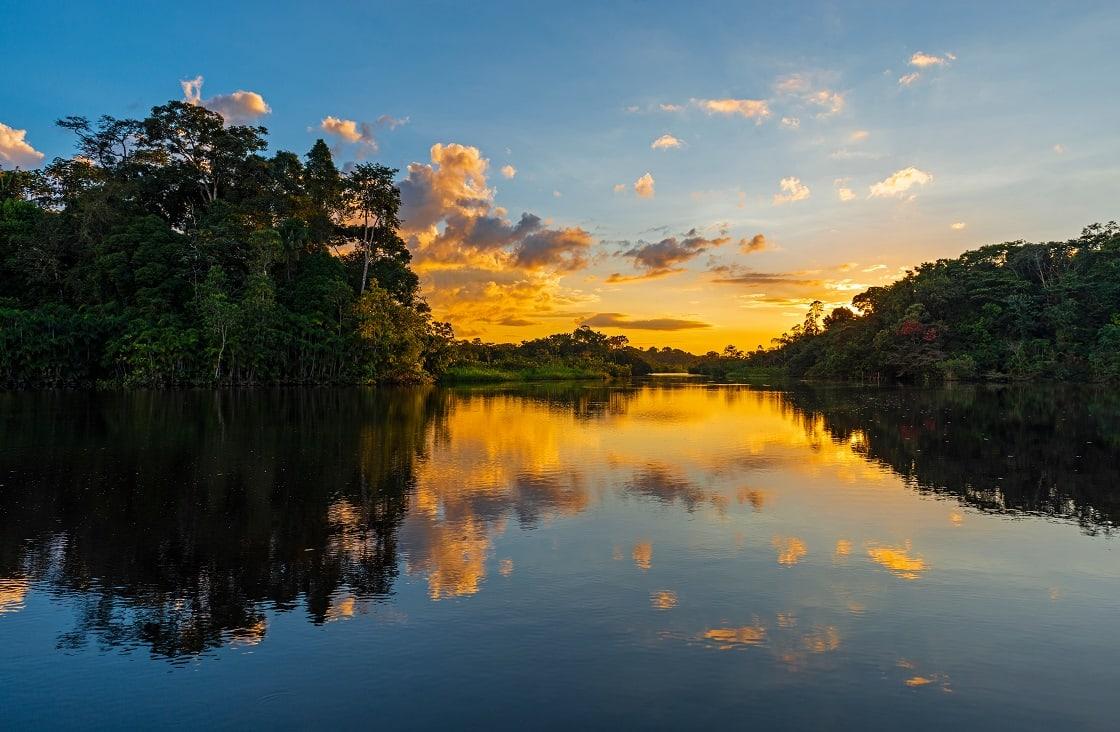 Sunset In The Amazon River Rainforest Basin