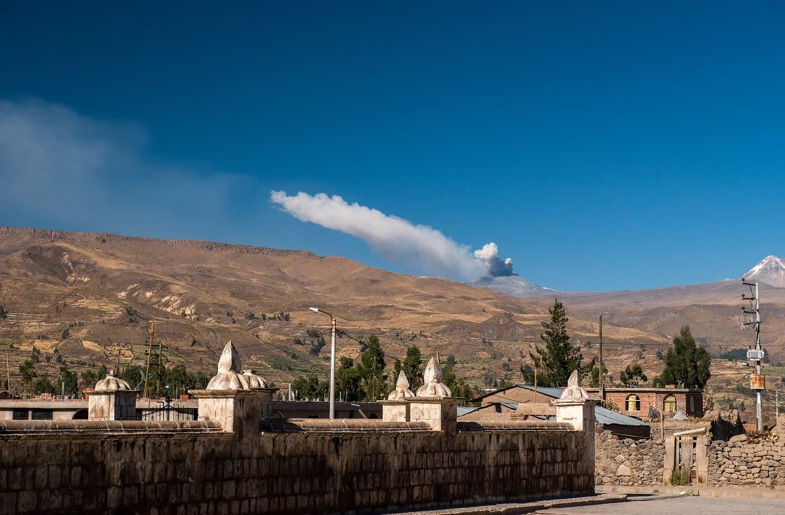 Yanque Village With Mismi Volcano Erupting, Arequipa