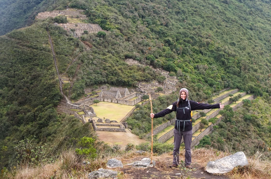 Hiker Celebrating Arrival At Choquequirao Ruins