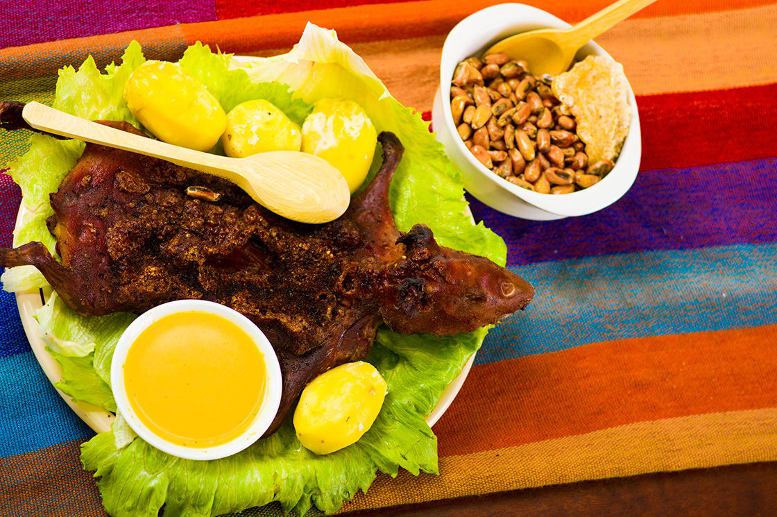 Traditional Ecuadorian Dish Grilled Guinea Pig Spread Out Onto Green
