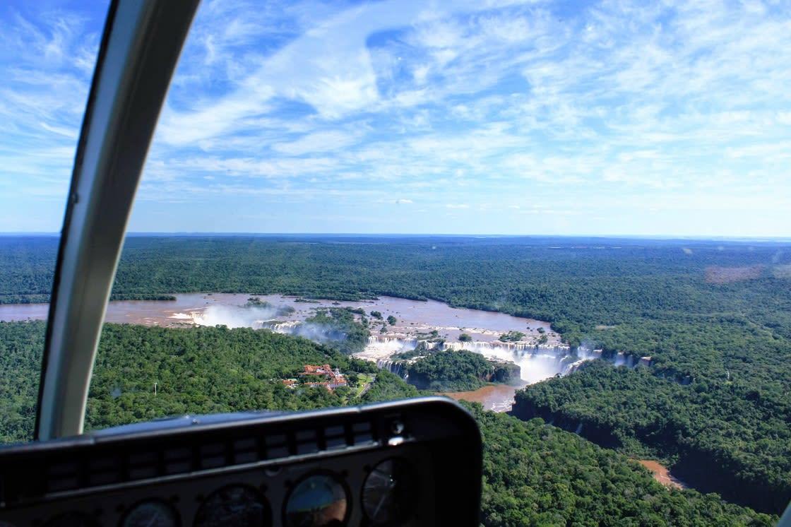 Tourists Flying Over Iguazu Falls By Helicopter In Iguaçu National
