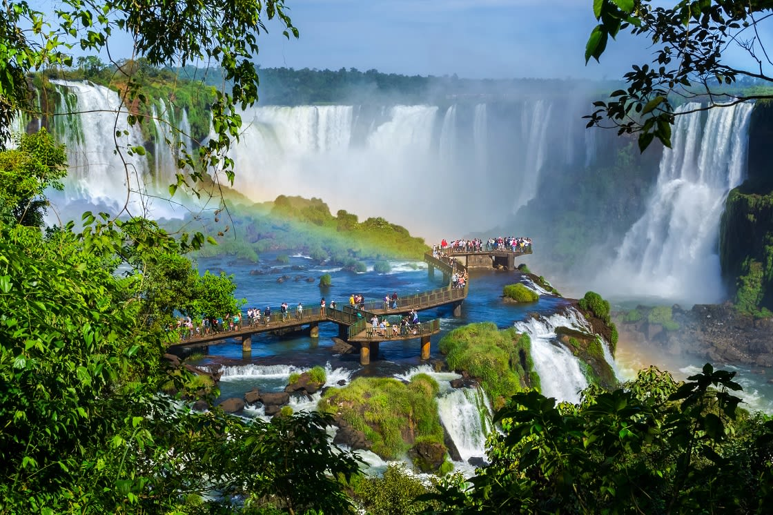 Tourists At Iguazu Falls One Of The World's Great Natural