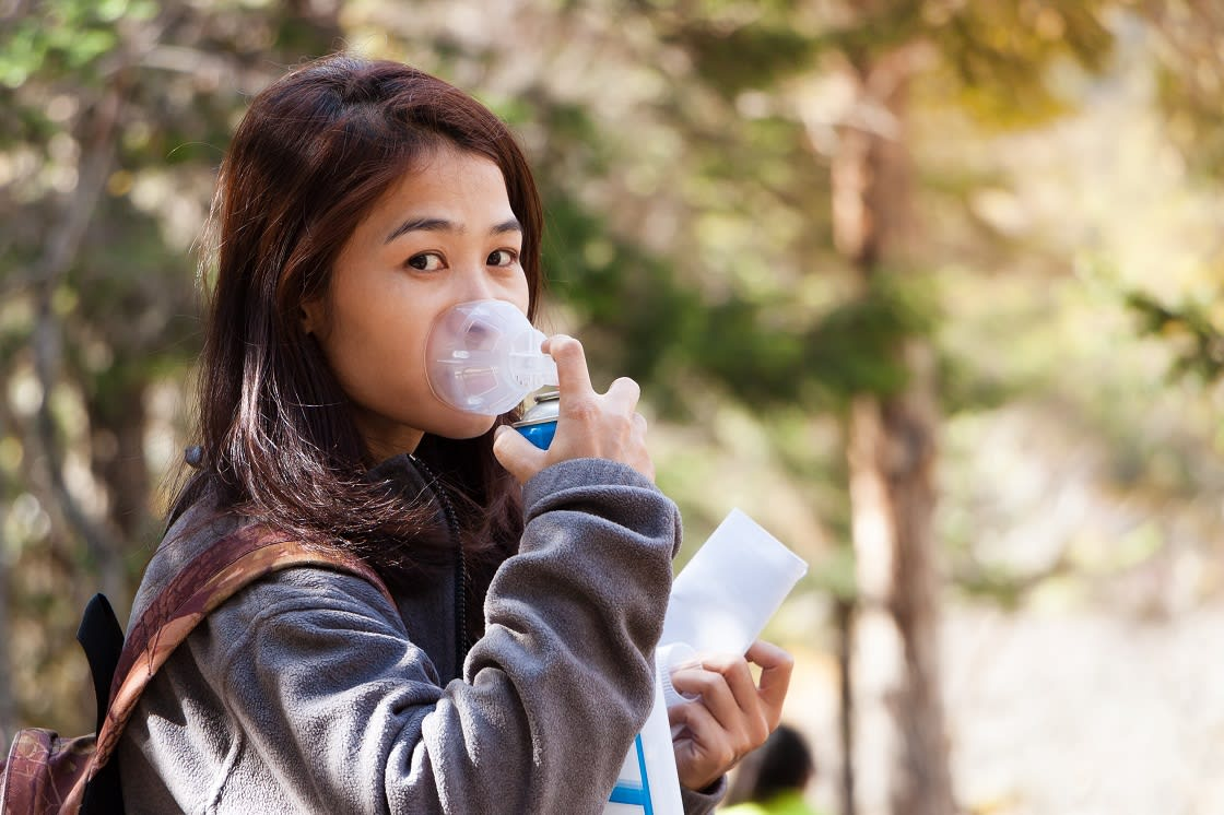 Tourist Using Oxygen Can For Prevent Altitude Mountain Sickness