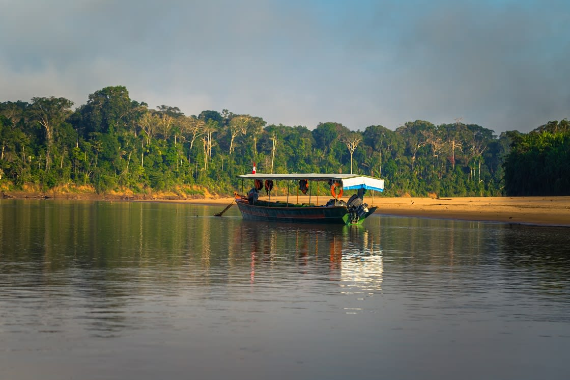 Tour Boat In The Rainforest Of Manu National Park