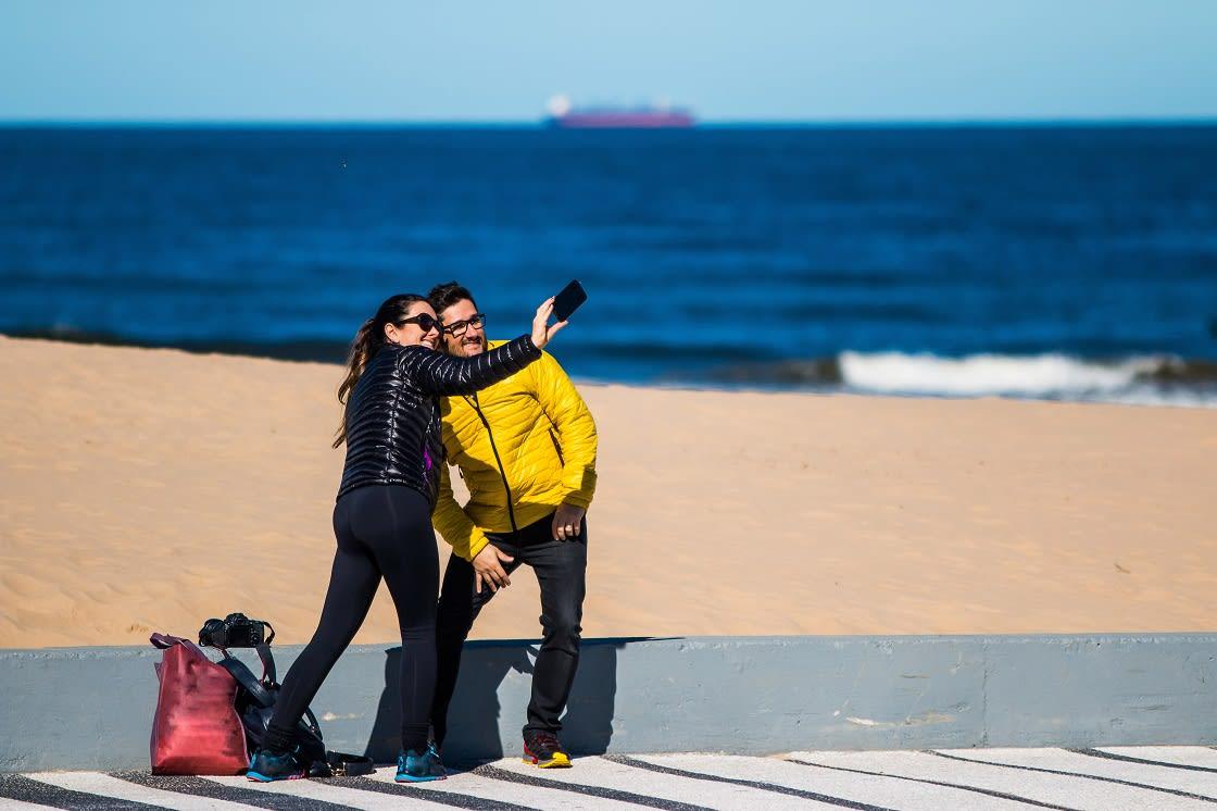 Couple Making Photos On Punta Del Este Beach