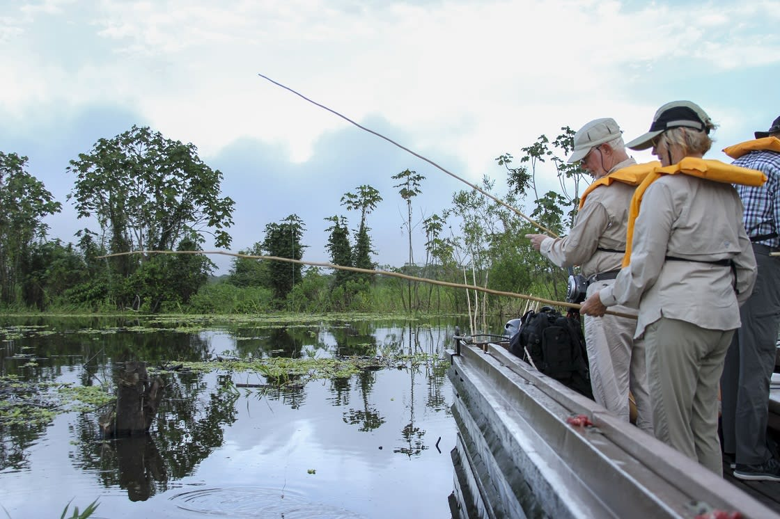 Group Of Tourists Out On A Piranha FIshing Excursion