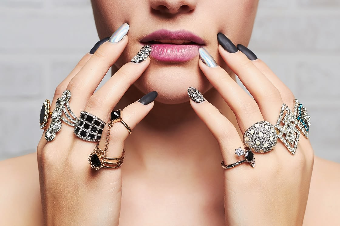 Woman's Hands With Jewelry Rings Beauty And Fashion Portrait Girl