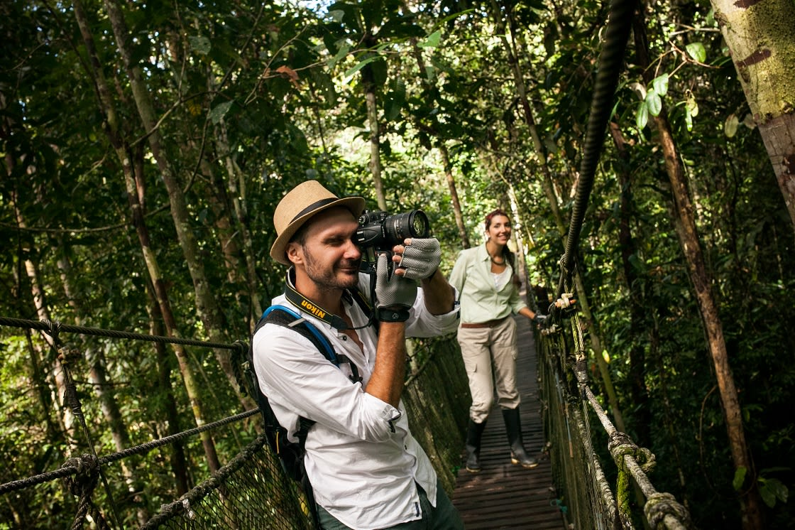 Tourist Taking Pictures at Canopy Walking In Iquitos - Peru
