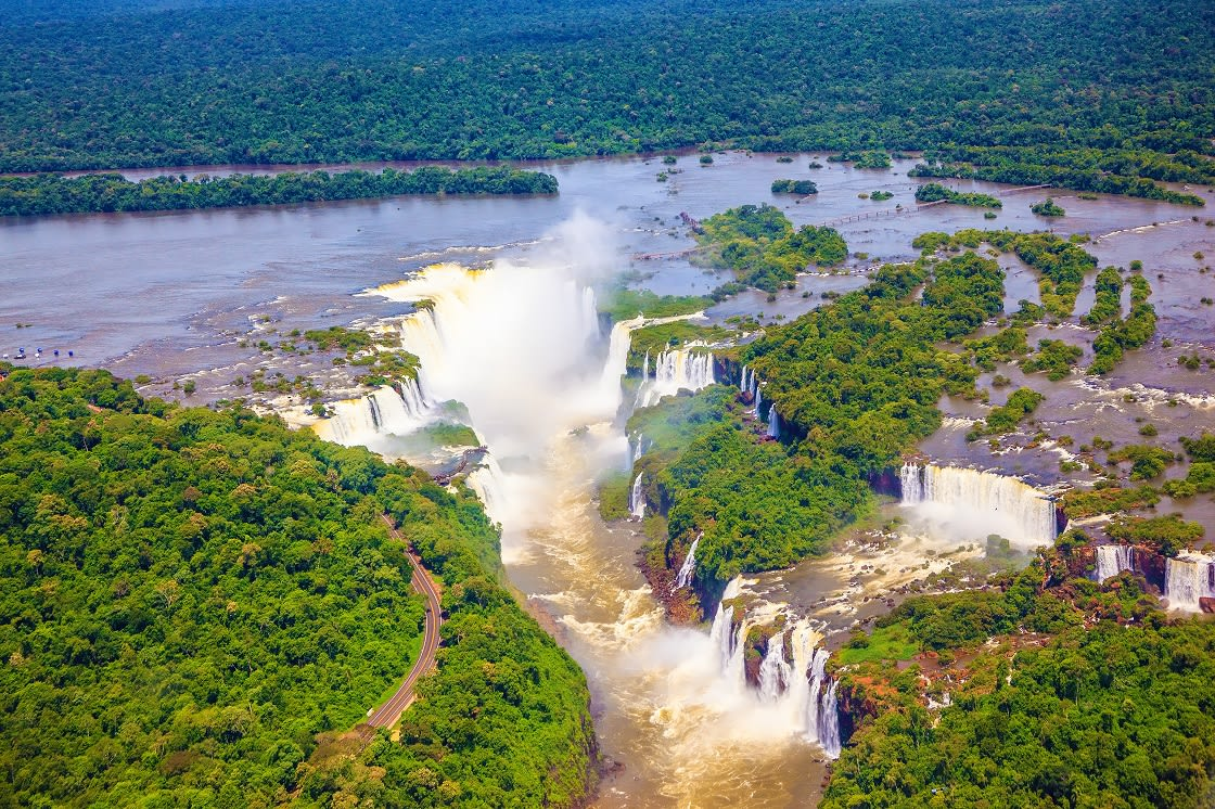 Iguazu River Spreads Widely Among The Dense Tropical Forest, Devil's Throat