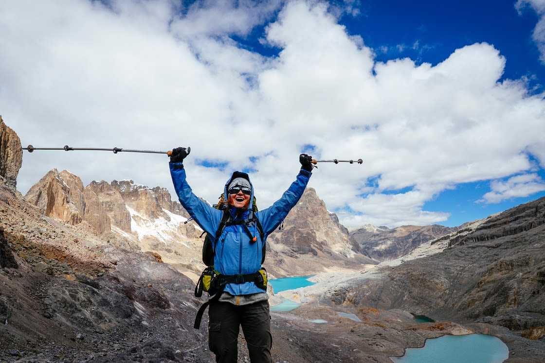 Female,Mountaineer,Cheers,On,A,5000,Meter,High,Pass,Along