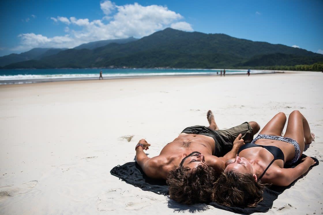 Young Couple Sunbathing In Brazil