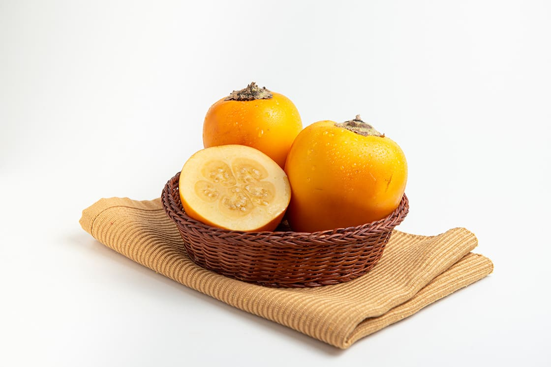 Fresh Tropical Fruit In A Rustic Bowl