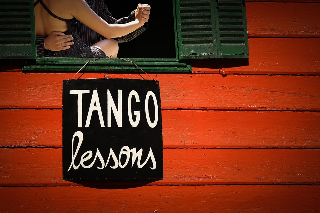 Tango lesson sign and couple dancing
