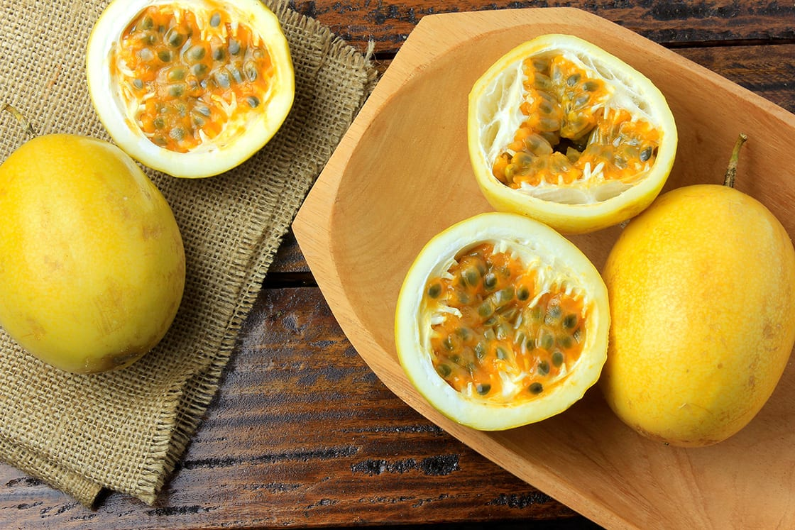 Yellow Passion Fruit and Passion Fruit Cut in a Half