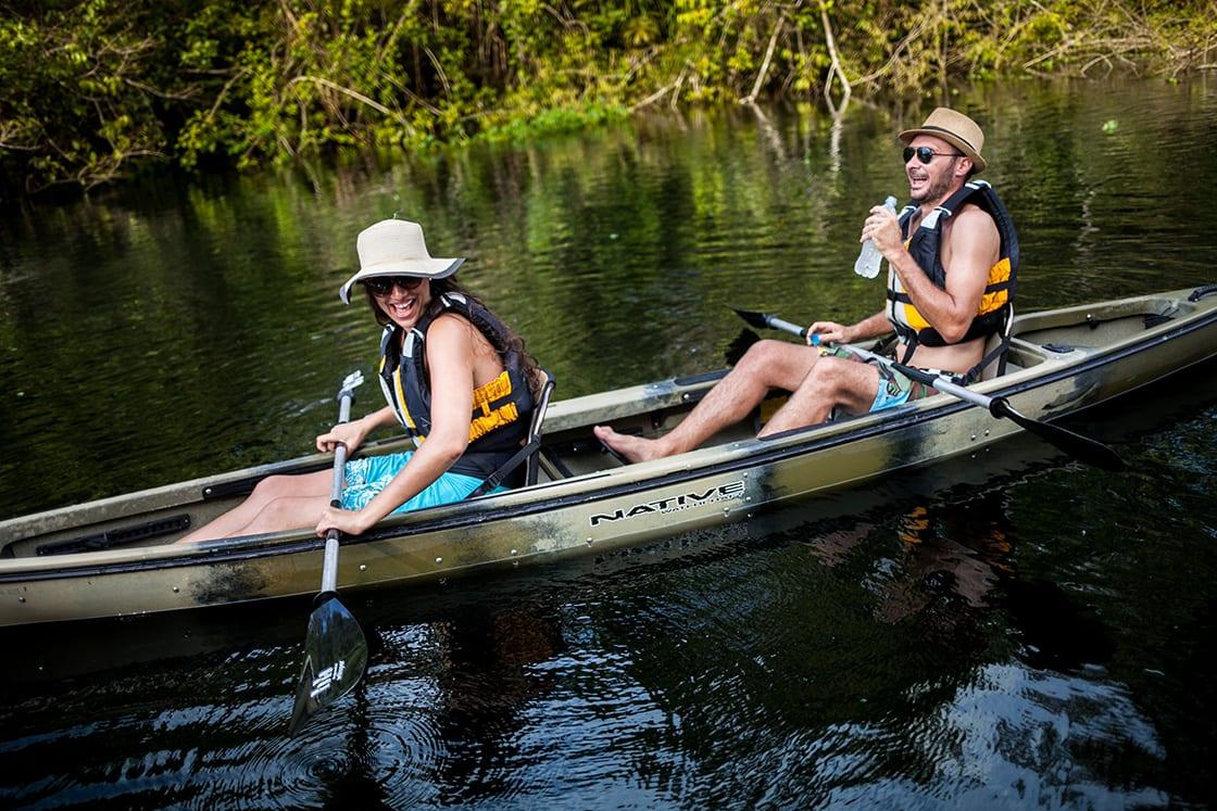Couple having fun while kayaking in the Amazon