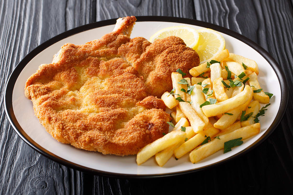 Fried Veal Cutlet Milanese With Lemon And French Fries