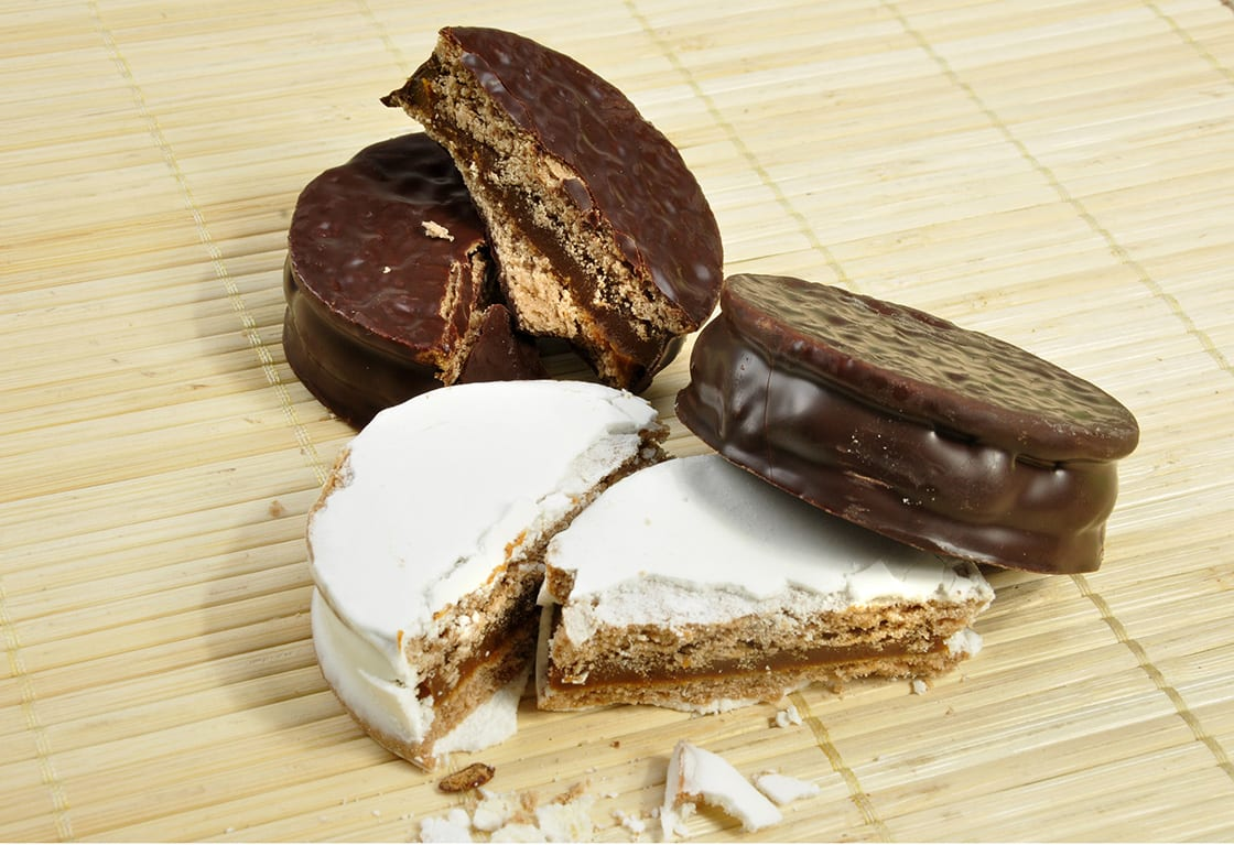 Alfajor Of Chocolate And Powederd With Sugar on a bamboo mat