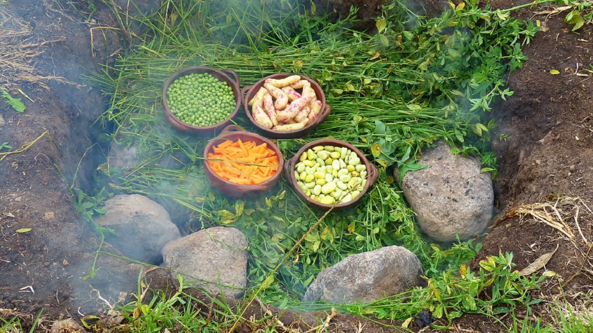 Some Vegetables Being Cooked Over The Underground Oven