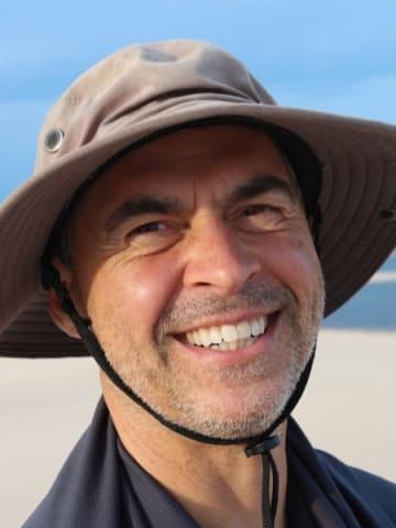 Happy Man Smiling On Beach