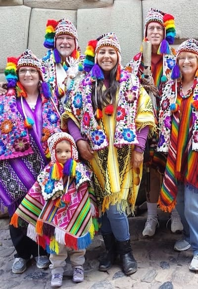 Family wearing colorful Andean clothing in Cusco