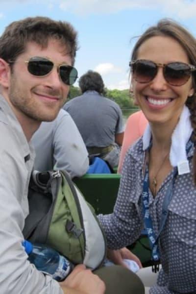 Happy Couple On Skiff In The Amazon