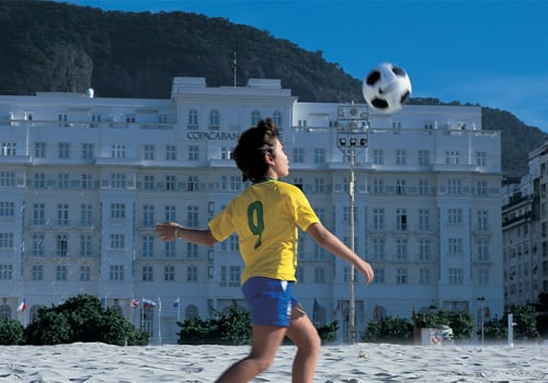 Child playing with a foot ball in Brazil