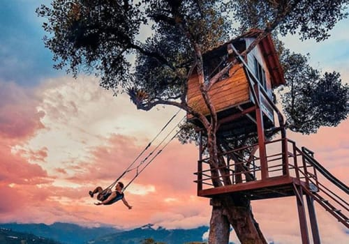 swing in front of sunset Banos