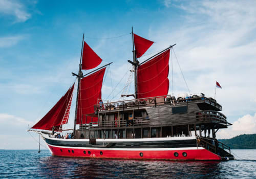 Yacht with red sails