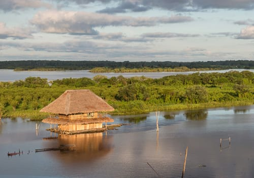 Panoramic View Of A Traditional House And The Amazon River