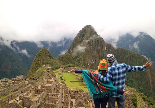 Couple,Admiring,The,Spectacular,View,Of,Machu,Picchu,,Cusco,Region,